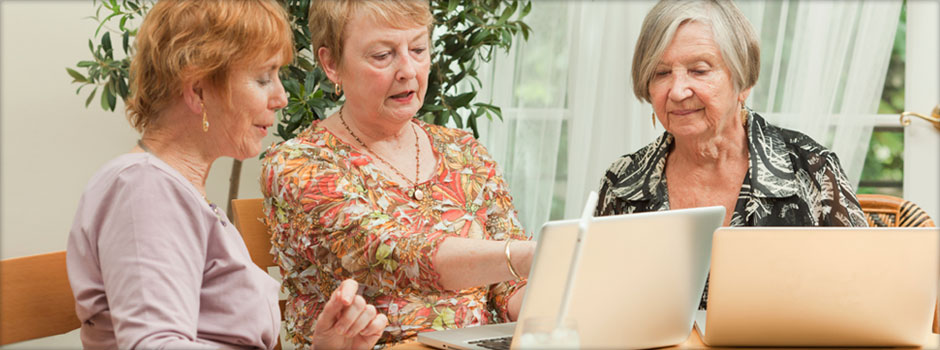 retired women on laptops